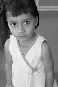 Black and White photo of serious looking child