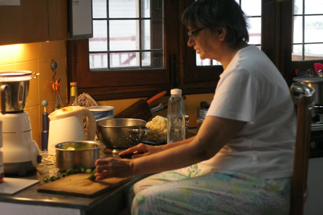Woman on a kitchen stool, cooking