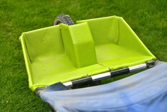 Footrest of stroller covered in thick green padding