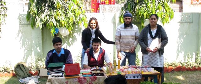 Trainees and staff from CVT selling candles and bags