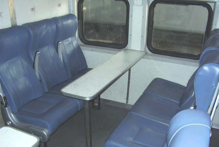 chair car seats on an indian train two rows facing each other