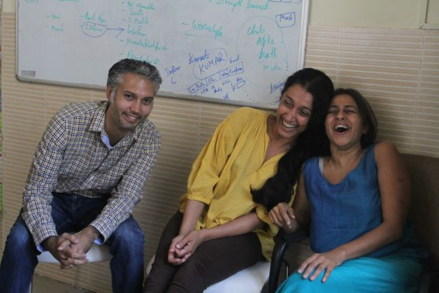 Three Indians, one man, two women - all laughing