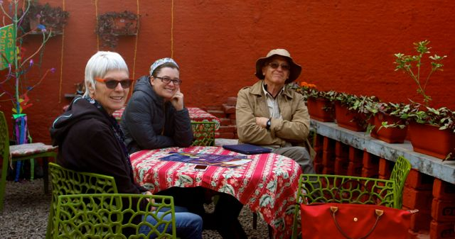 Three White Westerners sitting in an outdoor cafe