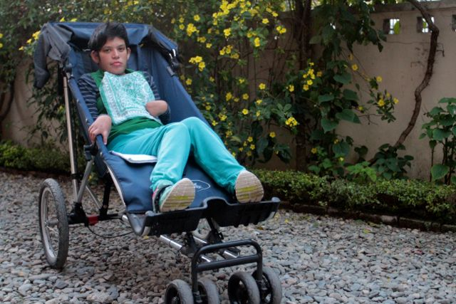Young woman with disability in an adaptive stroller