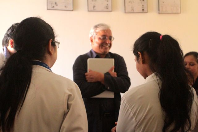 Doctor, smiling, talking with medical students