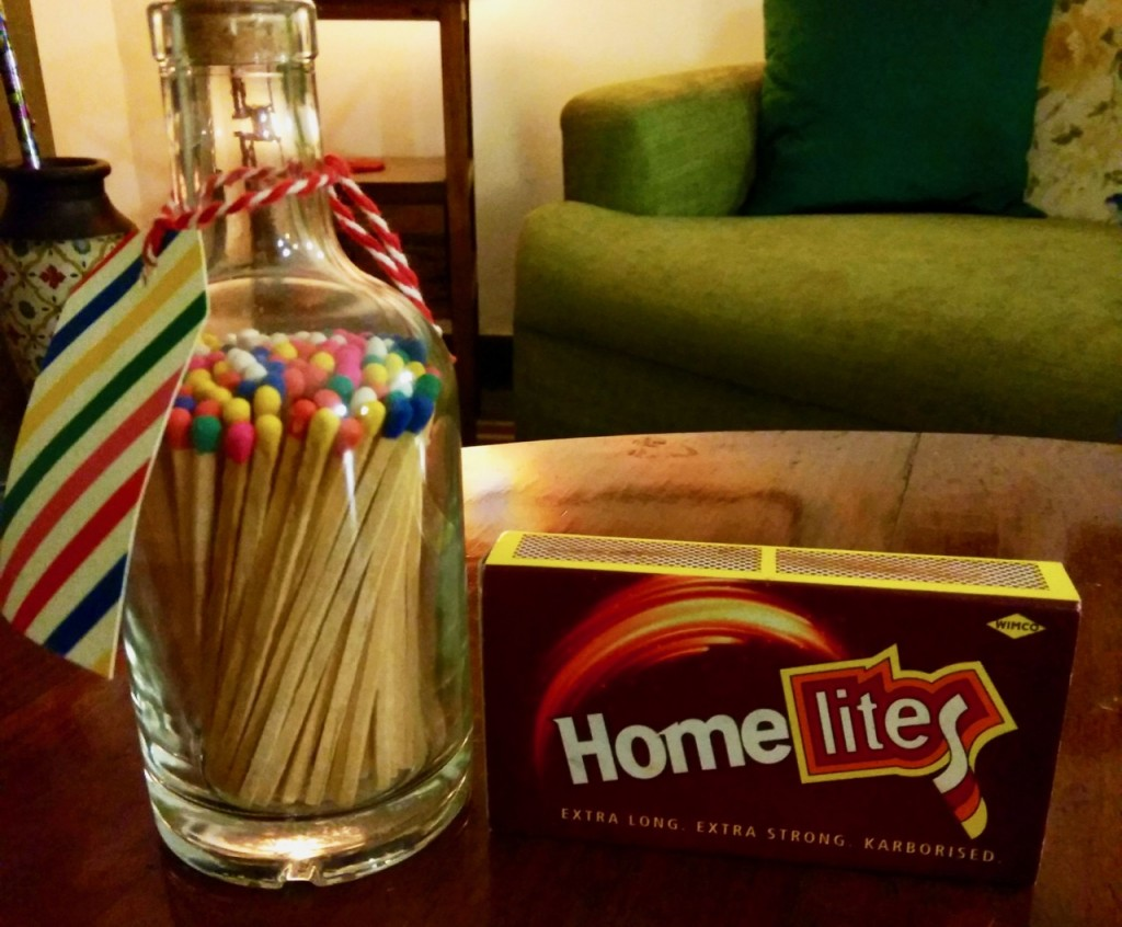 Glass bottle containing matches with brightly coloured heads; ordinary match box with regular matches