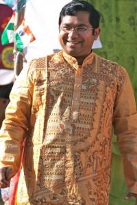 Smiling man in lavishly embroidered Bengali kurta