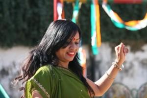 Woman in green Gujarati style sari, dancing