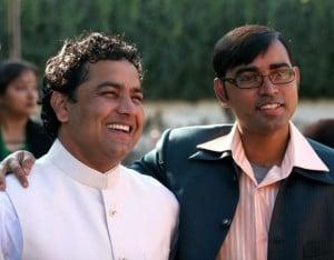 Two men together both smiling