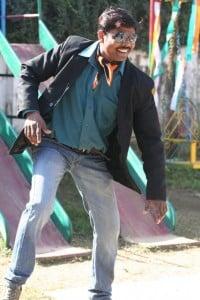 Stylish man in Western dress dancing to a pop tune