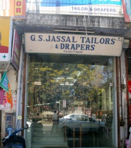 Storefront for tailor shop - glass doors, eight marble steps leading in to the shop