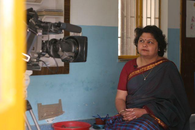School director being filmed