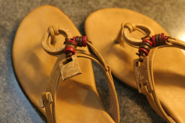 Pair of sandals; one has a broken strap