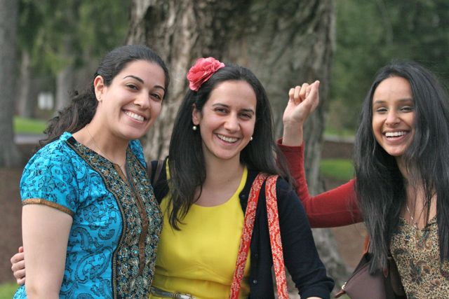 Three lovely girls by a tree