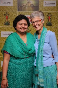Formal shot of Jo and Manju, both dressed in Turquoise