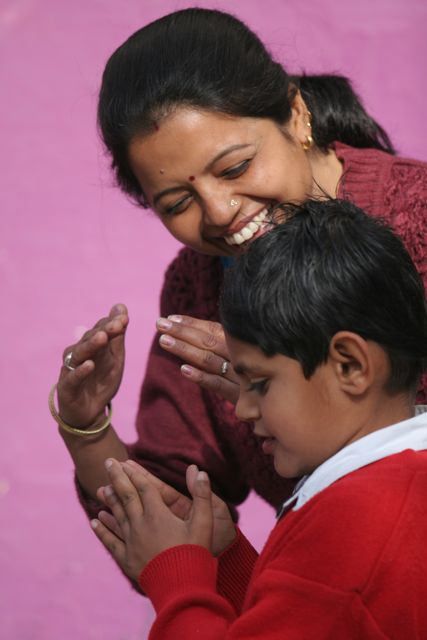 Teacher interpreting a child's story using sign language