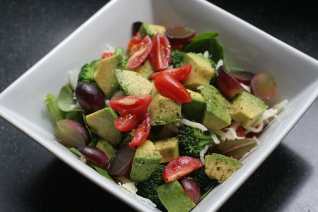Fresh, colorful salad in a square white bowl