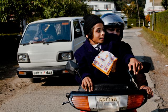 Child with CP with her mother on a motorbike