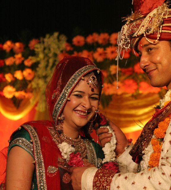 Indian bride and groom exchanging garlands