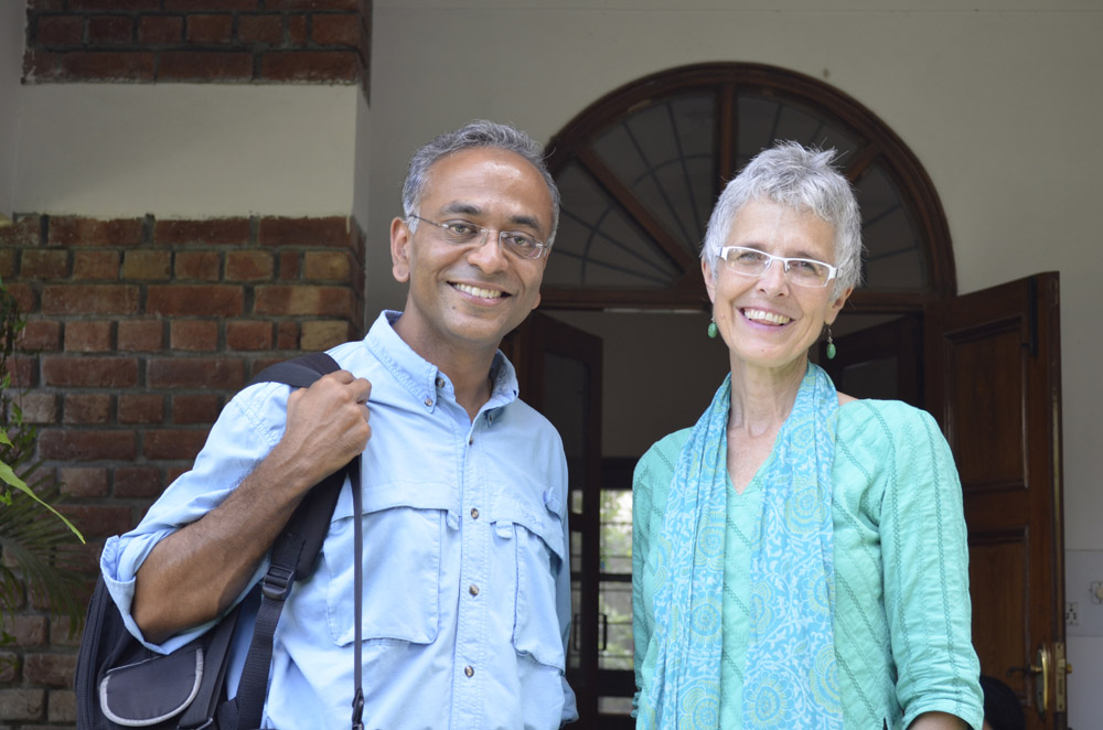 Smiling Indian man stands with the author (white haired American lady!)