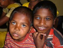 Portrait of two children with visual impairment in India - both are smiling!