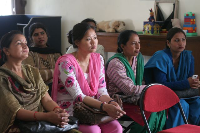 Indian women listening intently during a seminar