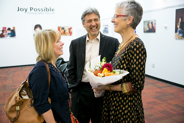 Jo (holding flowers) meeting Ken Carl and his wife