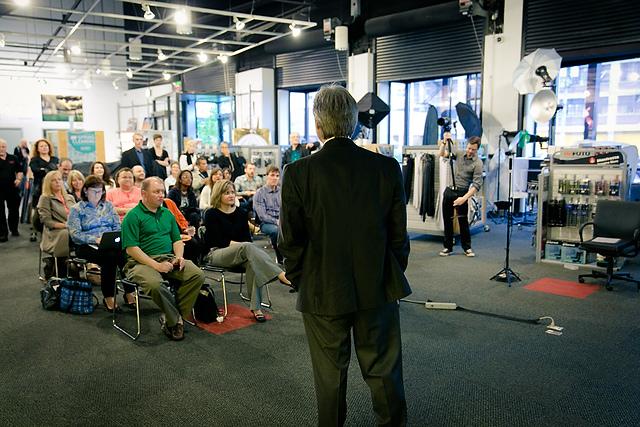 Ken addressing an audience on the shop floor of Calumet Photograph