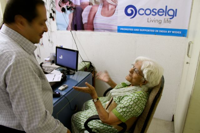 Elderly woman speaking with doctor