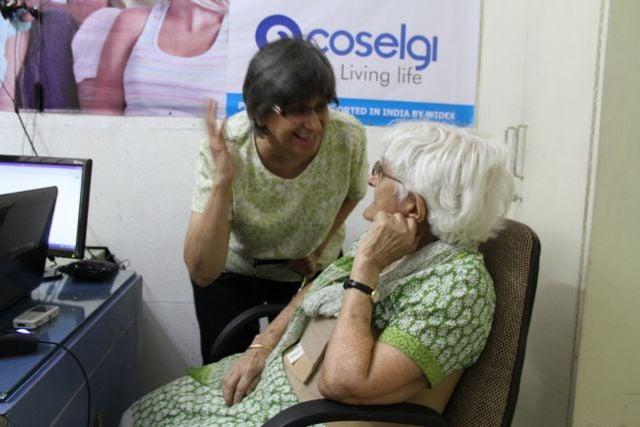 Daughter explaining something to her very elderly mother