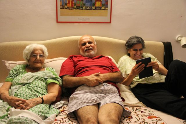 Old woman, her son and daughter sitting together looking very pleased!