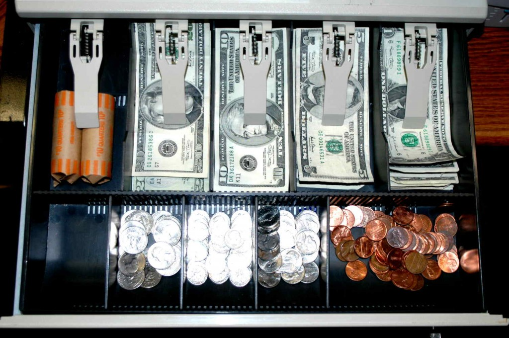 Cash drawer, all bills in separate slots, neat and tidy