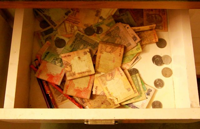 Drawer full of Indian currency, all helter skelter, no slots, jumbled all together