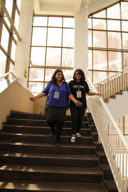 Two young women descending a flight of stairs