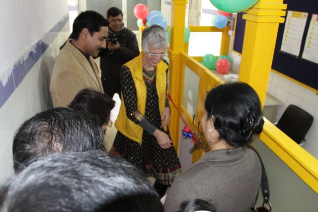 Officials cutting the ribbon to the NICU Support Station
