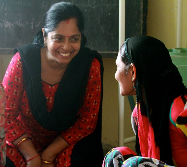 Smiling educator with village Mom