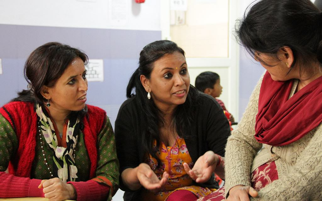 Social workers speaking lovingly to a Mom