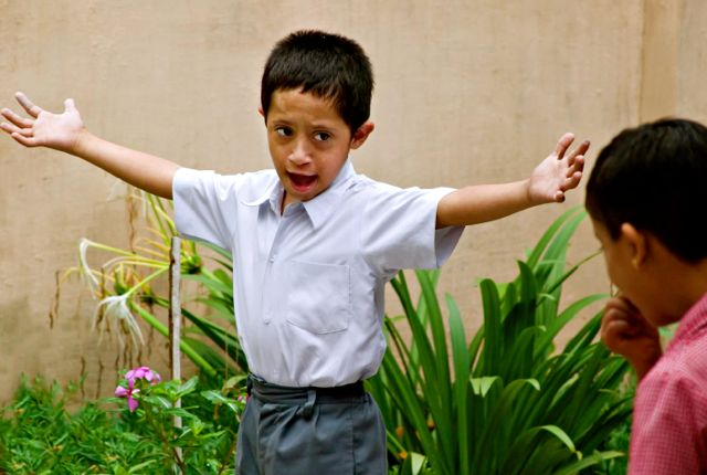 Kid with Down Syndrome, arms outstretched