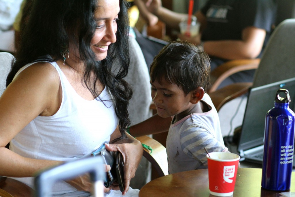 a little boy importuning a woman in a coffeeshop