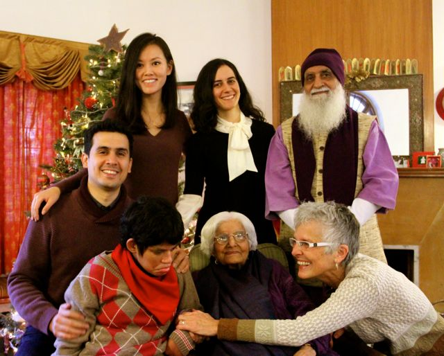 Family photo with kids, parents and grandma in front of Christmas tree