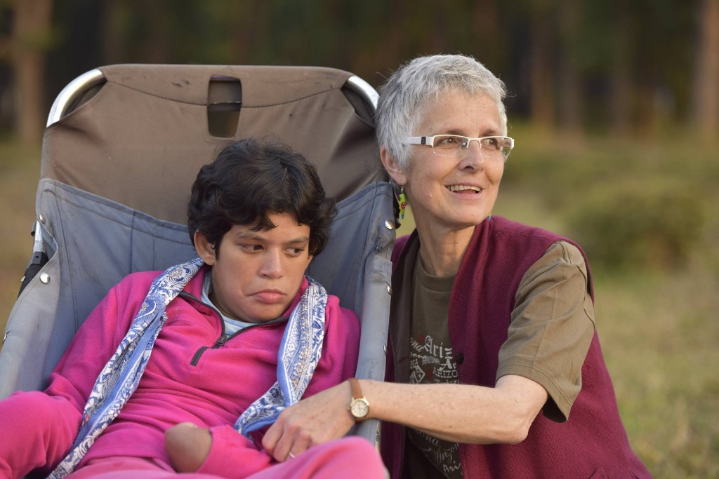 White haired woman beside young woman in a stroller