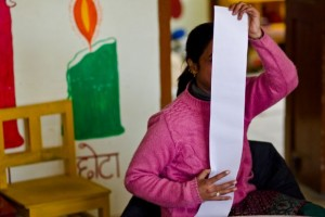 Young teacher measuring herself with a long strip of paper