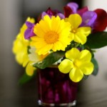 Small bouquet of yellow and purple flowers
