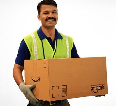 Indian delivery man holding a amazon.com package