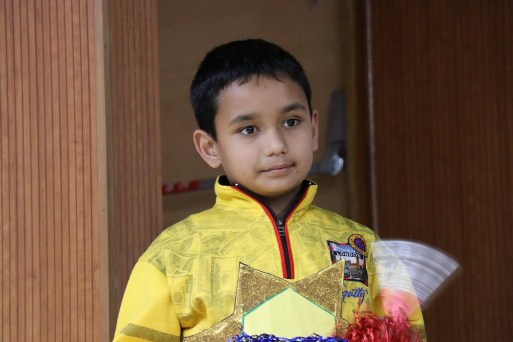 Little boy in a yellow jacket