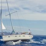 sailboat-on-blue-sea-near-land-e1478583570695-760x507