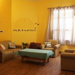 Attractive lounge with yellow walls and comfortable furniture