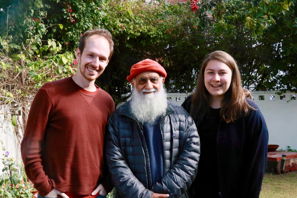 Young American couple with elderly bearded Indian man