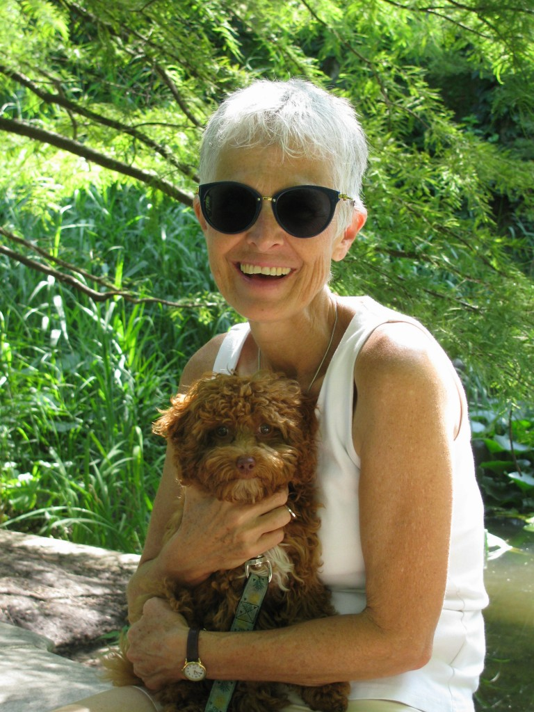 Happy white haired woman, holding very cute puppy