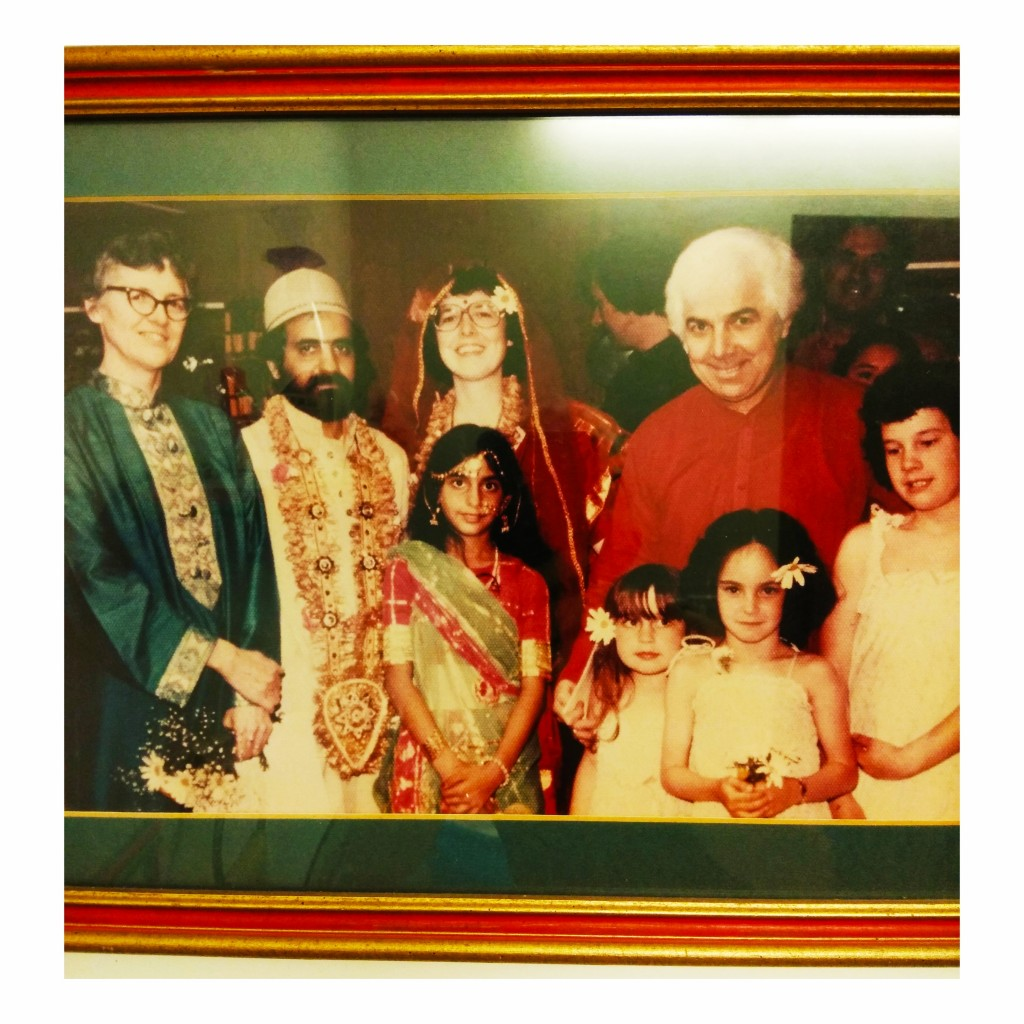 Indian American Bridal Party, American bride in red sari, Indian groom in white; bride's parents in Indian garb, four little girls in foreground